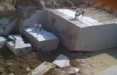 Crystal Yellow Rough Granite Blocks by Priyanka Construction